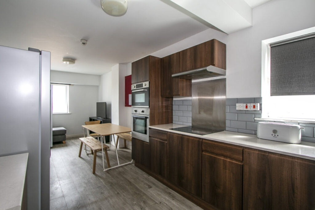 Typical shared flat lounge and kitchen in Winton Halls student accommodation
